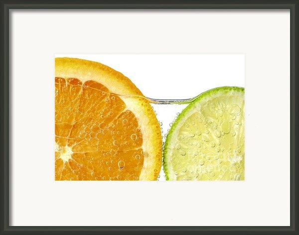 Orange And Lime Slices In Water Framed Print By Elena Elisseeva