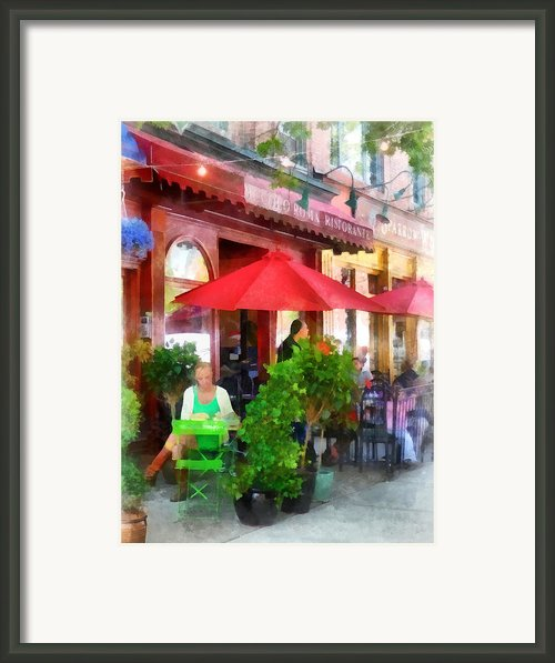 Outdoor Cafe With Red Umbrellas Framed Print By Susan Savad