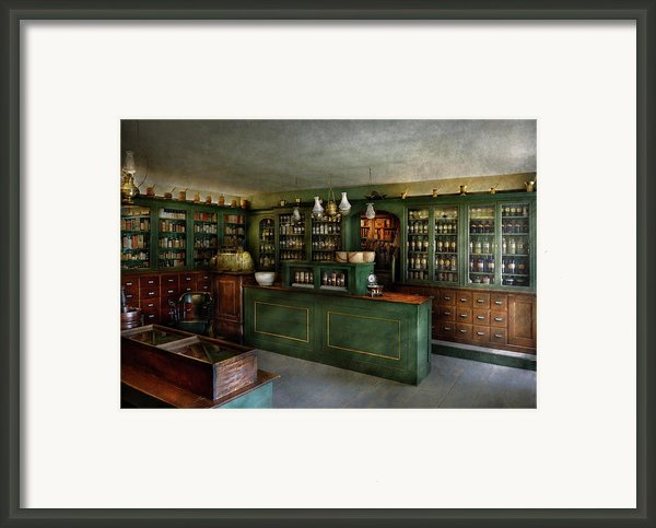 Pharmacy - The Chemist Shop  Framed Print By Mike Savad