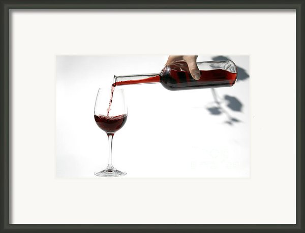 Pouring Red Wine Into Glass Framed Print By Patricia Hofmeester