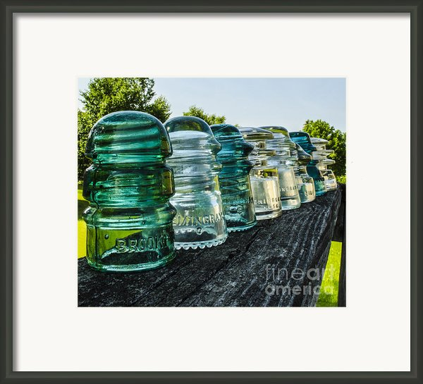 Pretty Glass Insulators All In A Row Framed Print By Deborah Smolinske