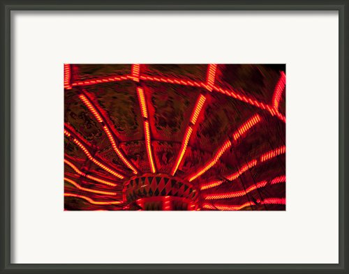 Red Abstract Carnival Lights Framed Print By Garry Gay