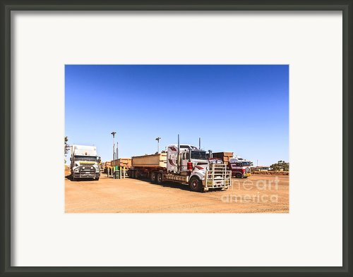 Road Trains Refuelling Framed Print By Colin And Linda Mckie