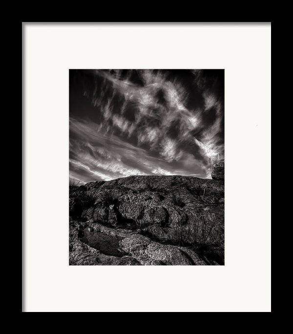 Rocks Clouds Water Framed Print By Bob Orsillo
