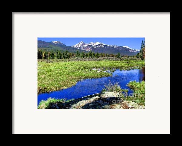 Rocky Mountains River Framed Print By Olivier Le Queinec
