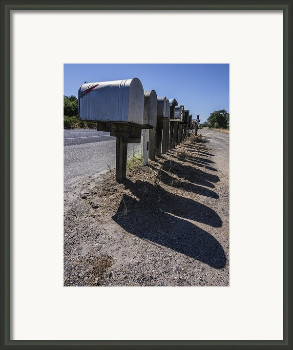 Row Of Mailboxes And Shadows Framed Print By David Litschel