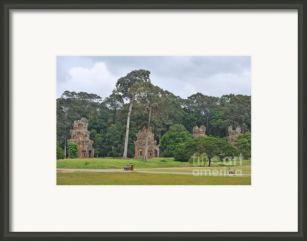 Ruins And Tourists At Angkor Wat Framed Print By Sami Sarkis