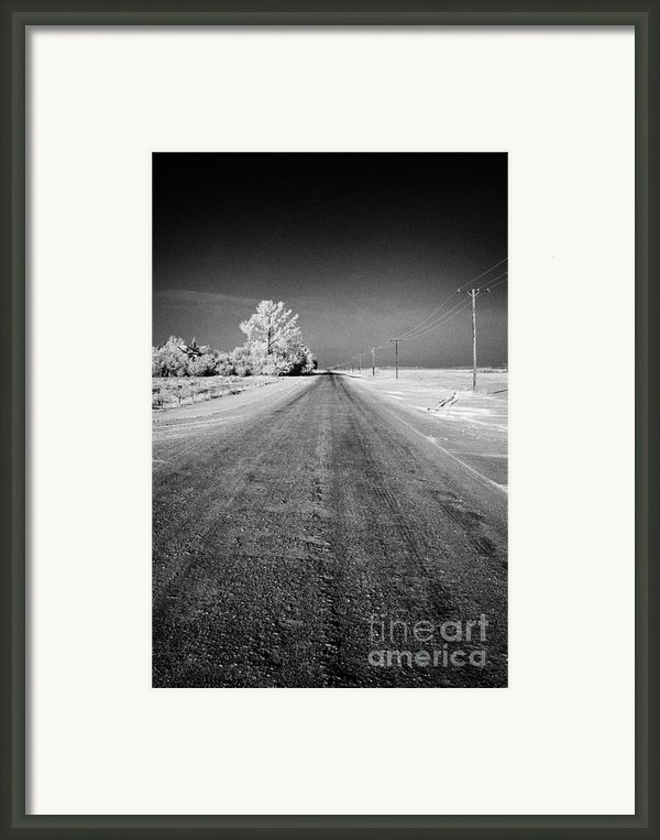 Salt And Grit Covered Rural Small Road In Forget Saskatchewan Canada Framed Print By Joe Fox