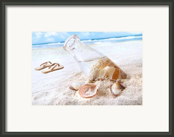 Seashells In A Bottle On The Beach Framed Print By Sandra Cunningham