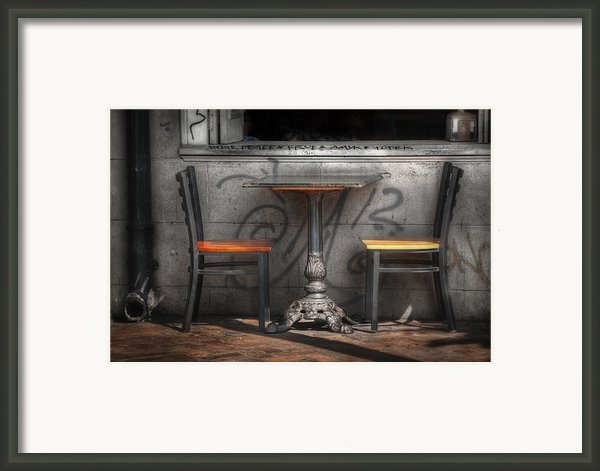 Sidewalk Seating Framed Print By Brenda Bryant
