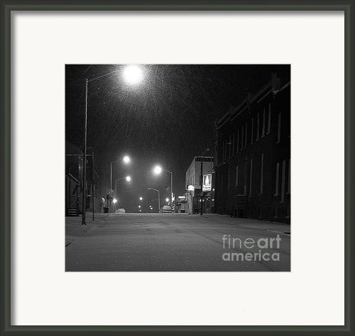 Snowing On W. Fourth St. Framed Print By Julie Dant