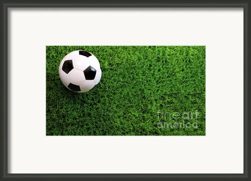Soccer Ball On Green Grass Framed Print By Sandra Cunningham