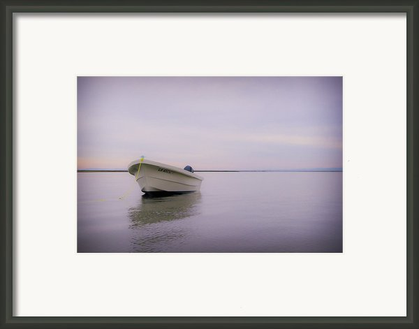 Solitary Boat Framed Print By Adam Romanowicz