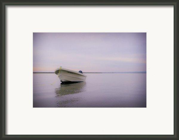 Solitary Boat Framed Print By Adam Romanowicz