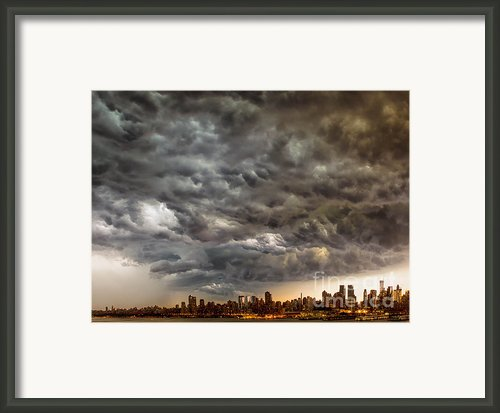 Storm Coulds Over Nyc Framed Print By Jerry Fornarotto