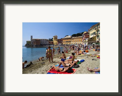 Sun Bathers In Sestri Levante In The Italian Riviera In Liguria Italy Framed Print By David Smith