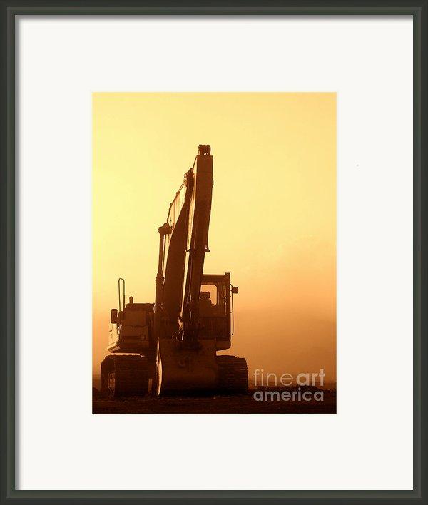 Sunset Excavator Framed Print By Olivier Le Queinec