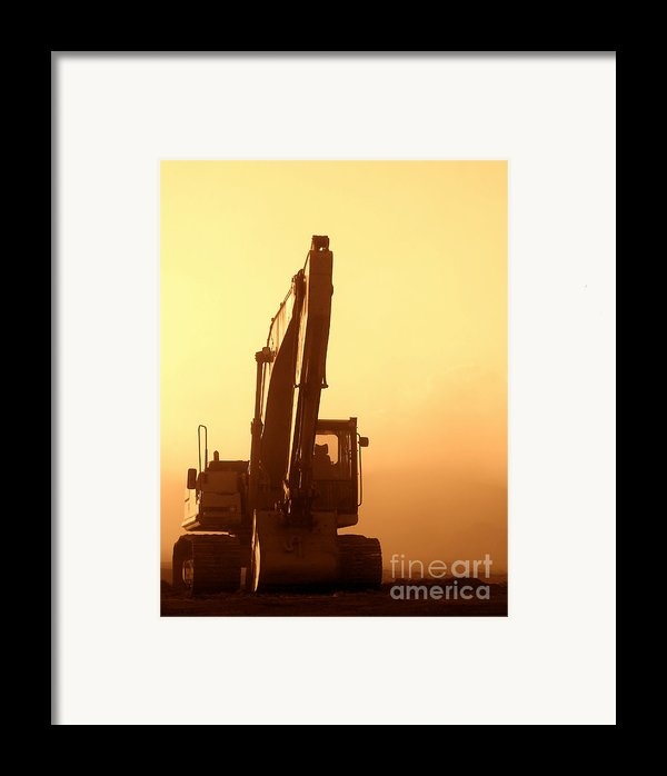 Sunset Excavator Framed Print By Olivier Le Queinec