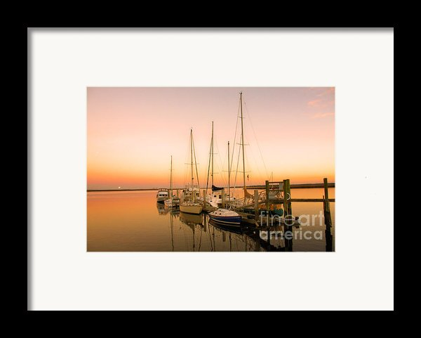 Sunset On The Dock Framed Print By M J Glisson