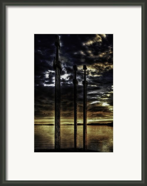 Swords In Rock Framed Print By Erik Brede