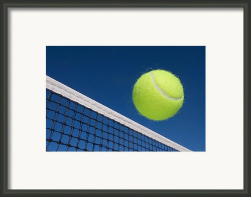 Tennis Ball And Net Framed Print By Joe Belanger