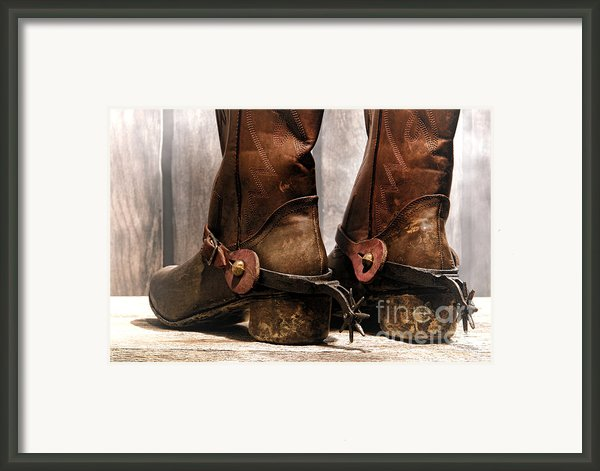 The Muddy Boots Framed Print By Olivier Le Queinec