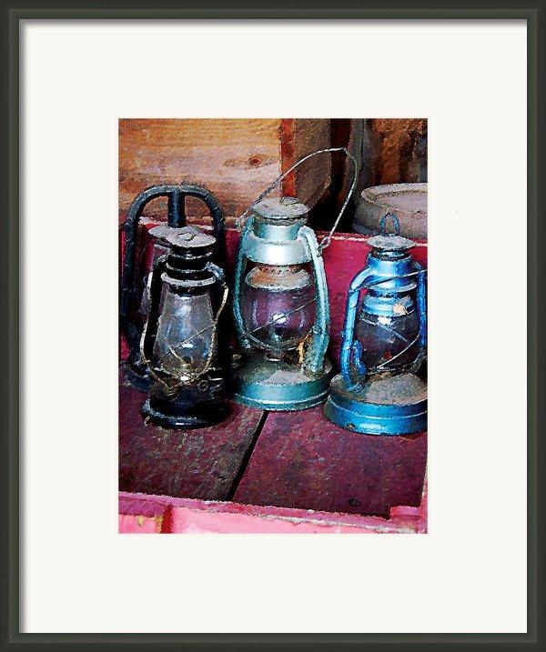 Three Kerosene Lamps Framed Print By Susan Savad
