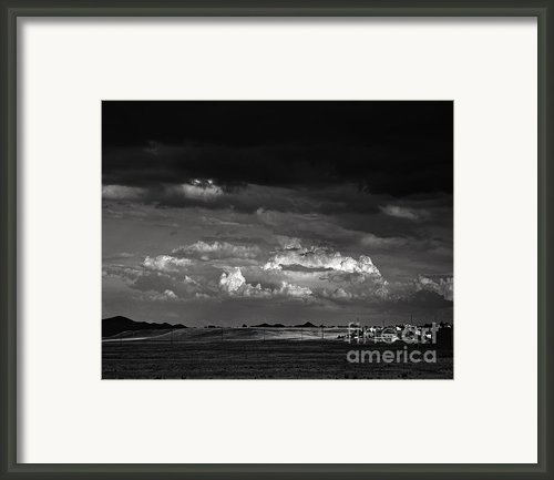 Towns End Framed Print By Arne Hansen