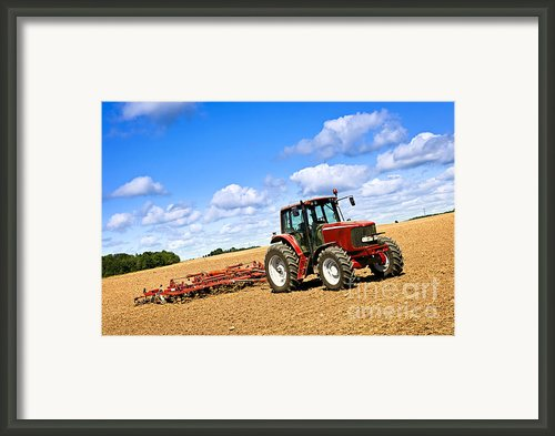 Tractor In Plowed Farm Field Framed Print By Elena Elisseeva