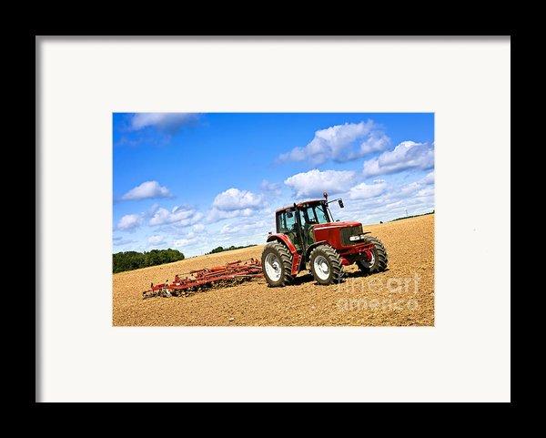 Tractor In Plowed Farm Field Framed Print By Elena Elisseeva