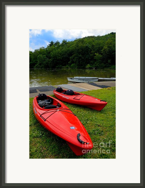 Two Red Kayaks Framed Print By Amy Cicconi
