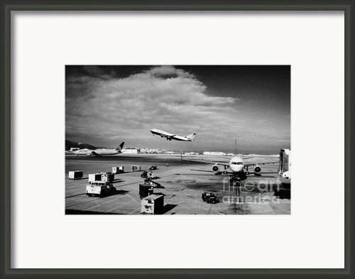 United Airlines Aircraft Taking Off Taxiing And On Stand At The San Francisco International Airport  Framed Print By Joe Fox