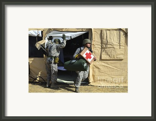 U.s. Air Force Soldier Exits A Medical Framed Print By Stocktrek Images