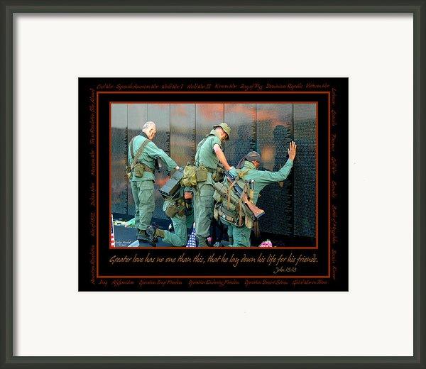 Veterans At Vietnam Wall Framed Print By Carolyn Marshall