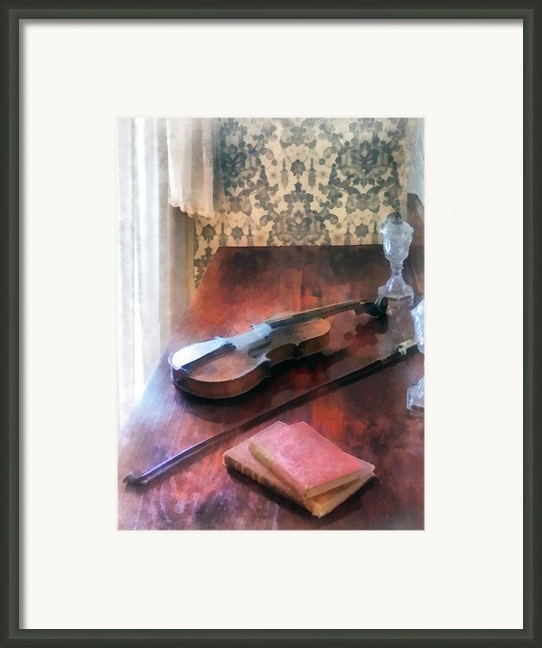 Violin On Credenza Framed Print By Susan Savad