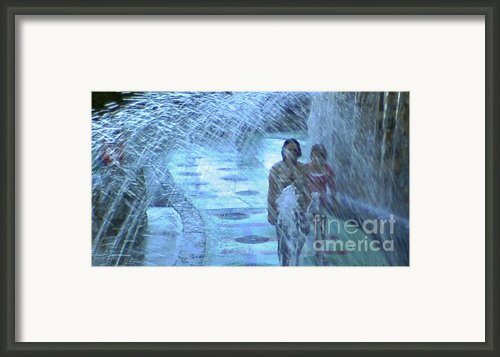 Walking Through The Fountains Framed Print By Gina Manley