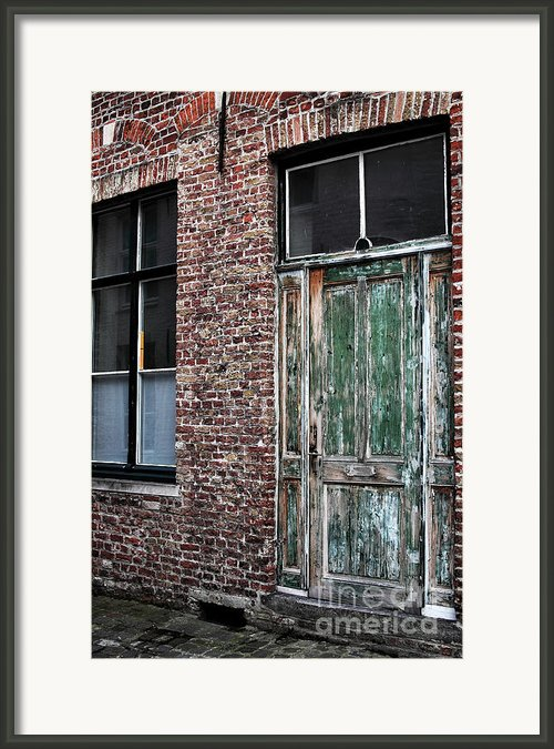 Weathered Bruges Framed Print By John Rizzuto