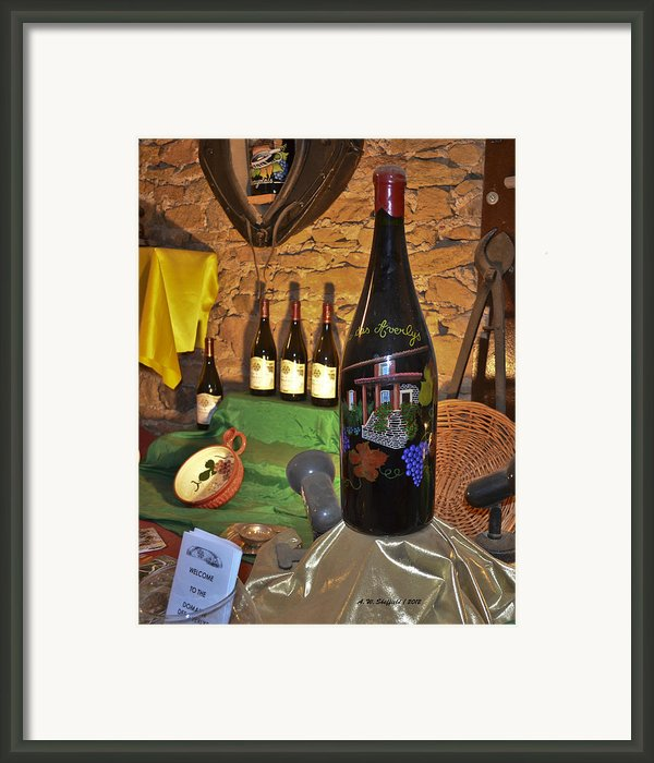 Wine Bottle On Display Framed Print By Allen Sheffield
