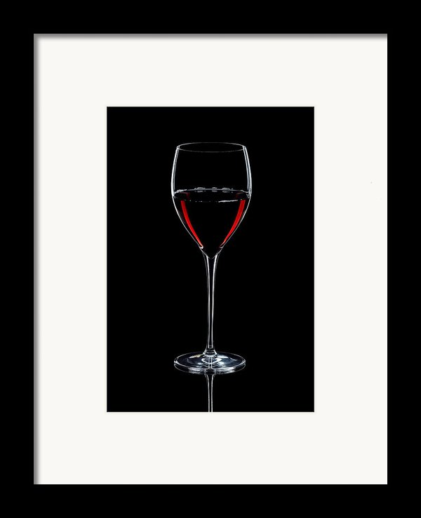 Wineglass Filled With Red Wine Silhouette Framed Print By Alex Sukonkin
