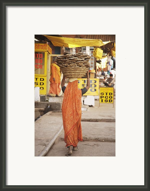 Woman Carrying Cow Dung In Basket On Framed Print By Paul Miles