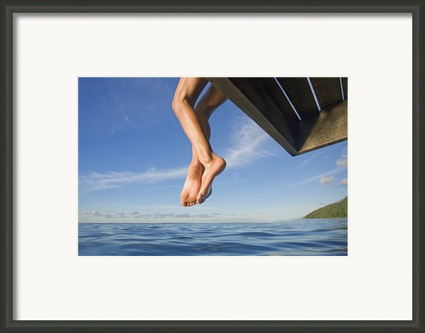 Womans Legs Hanging From Dock Framed Print By M Swiet Productions