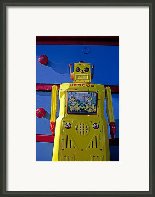 Yellow Robot In Front Of Drawers Framed Print By Garry Gay