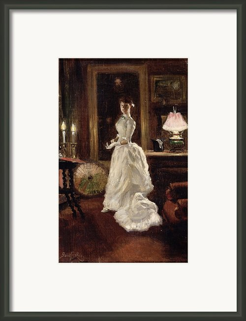 Interior Scene With A Lady In A White Evening Dress  Framed Print By Paul Fischer