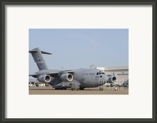 A C-17 Globemaster Iii Parked Framed Print By Stocktrek Images