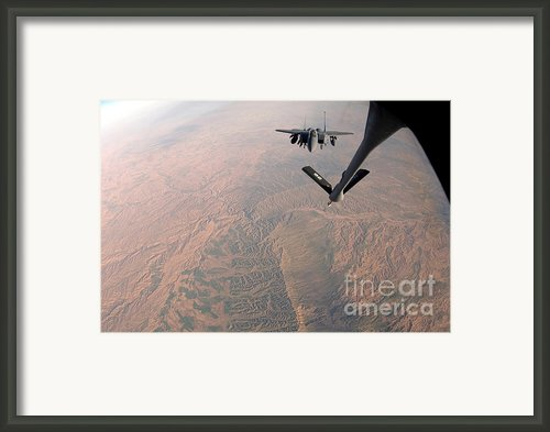 An F-15e Strike Eagle Is Refueled Framed Print By Stocktrek Images