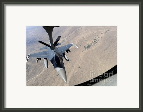 An F-16 Fighting Falcon Receives Fuel Framed Print By Stocktrek Images