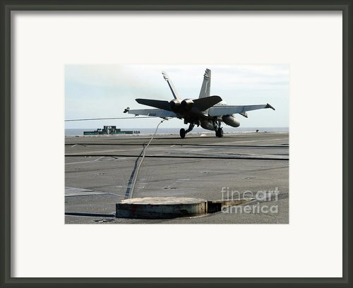 An Fa-18c Hornet Makes An Arrested Framed Print By Stocktrek Images