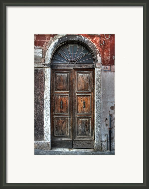 An Old Wooden Door In Italy Framed Print By Joana Kruse