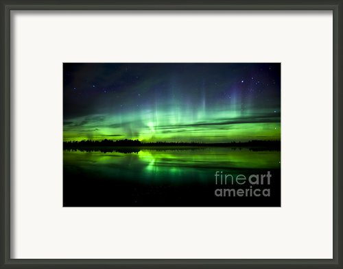 Aurora Borealis Near The Village Framed Print By Zoltan Kenwell
