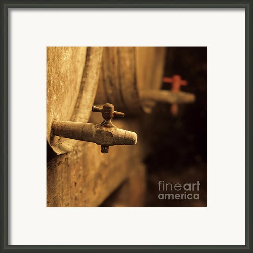 Barrels Of Wine In A Wine Cellar. France Framed Print By Bernard Jaubert